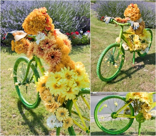 Floral bicycles on display on roundabouts in Elmbridge on the Olympic Cycling Routes