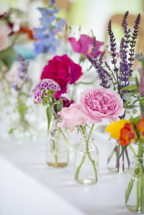 7.-Mixed-top-table-bottle-arrangement-David-Austin-Roses