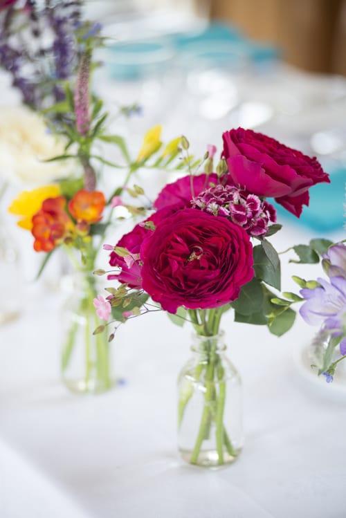 8..-Mixed-top-table-bottle-arrangement-(Darcey)--David-Austin-Roses