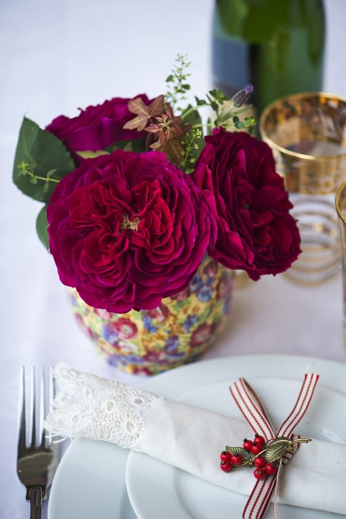 Darcey-tablecentre-arrangement-in-antique-jug-David-Austin-Roses