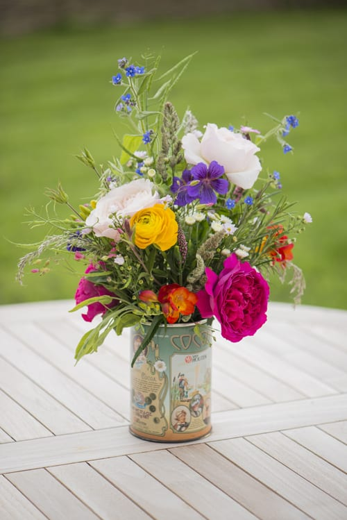Mixed-cottage-garden-arrangement-in-vintage-tin--David-Austin-Roses