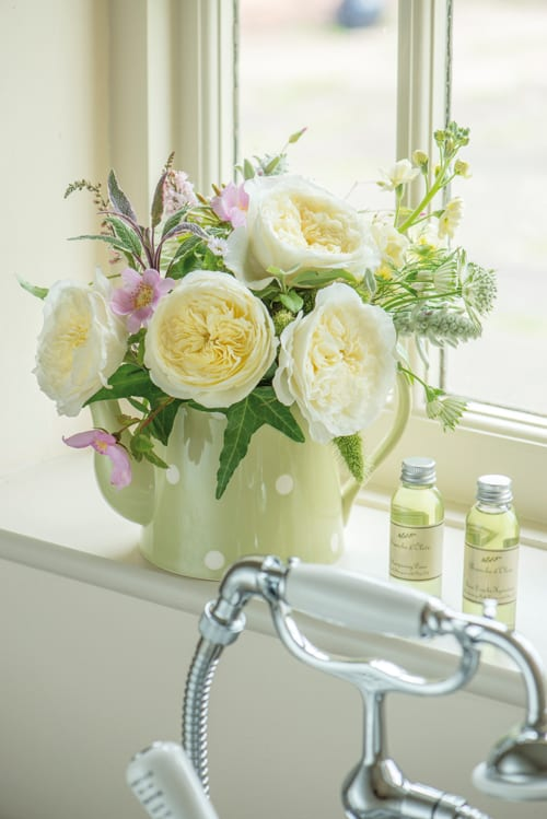 Patience-cottage-garden-arrangement-in-teapot-David-Austin-Roses