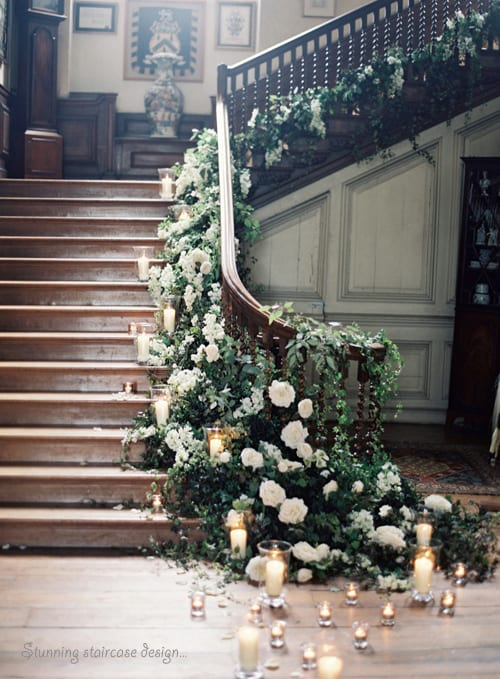 Rebecca-Lindon-Staircase-adorned-with-white-flowers