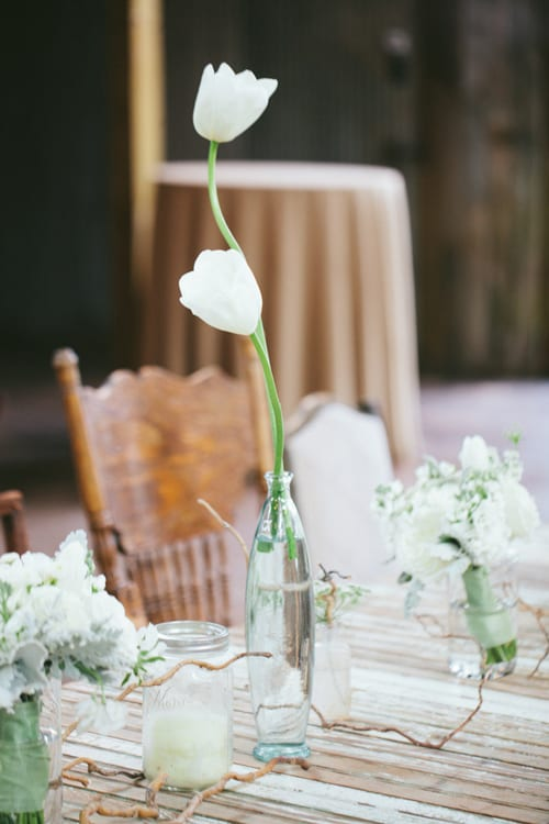 Style-Me-Pretty-Loft-Photographie-White-Tulips-in-Bottle