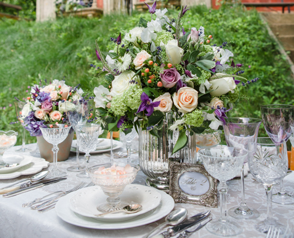 Beautiful purple & peach wedding flower designs by Sarah Harper Flowers