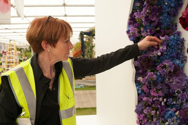 Ming-Veevers-Carter-putting-the-finishing-touches-on-New-Covent-Garden-Flower-Market's-debut-stand,-'Behind-Every-Great-Florist',-designed-by-Veevers-Carter-Flowerona