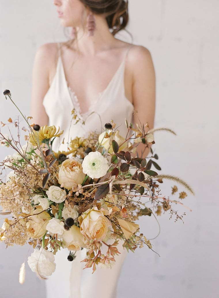 Muted yellow bridal bouquet by SWEET WOODRUFF with photography by ARTIESE STUDIOS and styling by MAGDALENE KAN