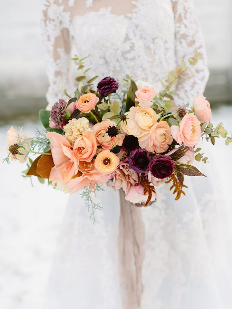Pale peach and burgundy bridal bouquet by Habitat Floral Studios at a magical winter wedding, captured by Larissa Cleveland Photography
