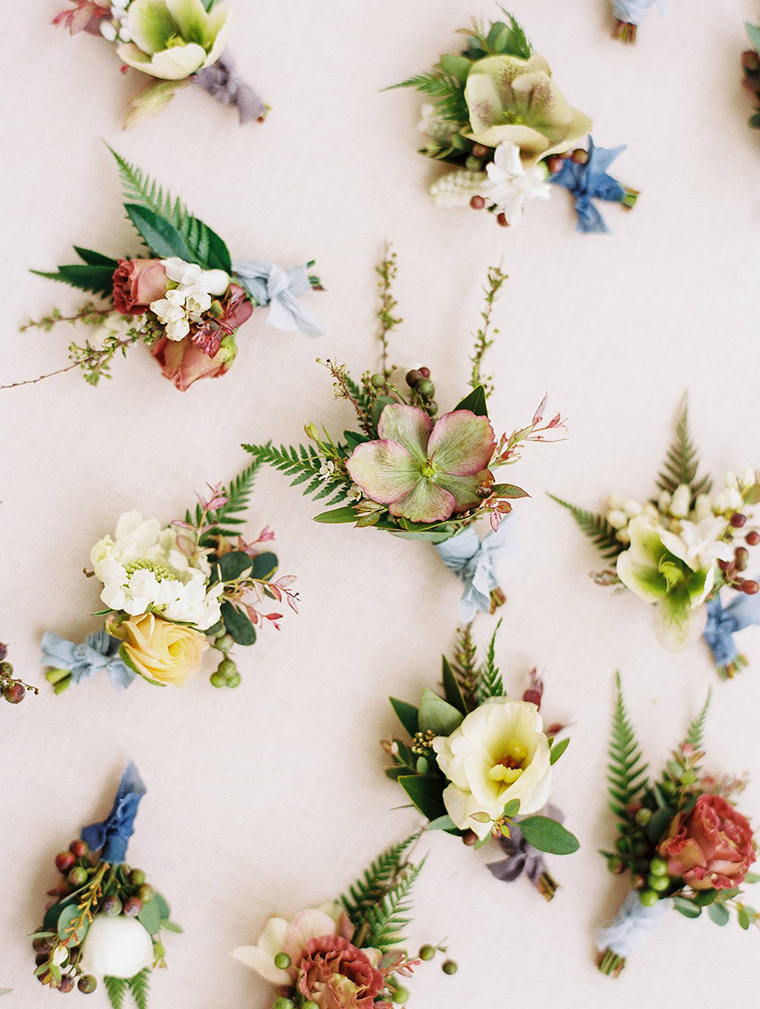 Beautiful assorted floral buttonholes featuring hellebores, roses and scabious. Created by florist Jessica Zimmerman and photographed by wedding photographer Erin Wilson