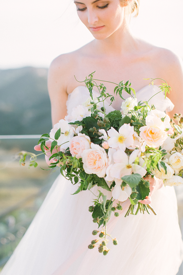 Stunning pale peach bridal bouquet brimming with roses and rubus by Adri at Moss Floral Design