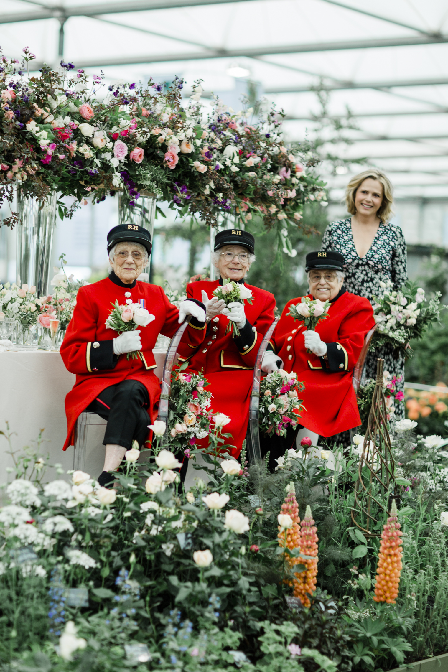 Liz Earle Rosie Morton with lady Chelsea Pensioners at the RHS Chelsea Flower Show 2019
